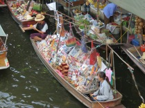 A floating market vendor